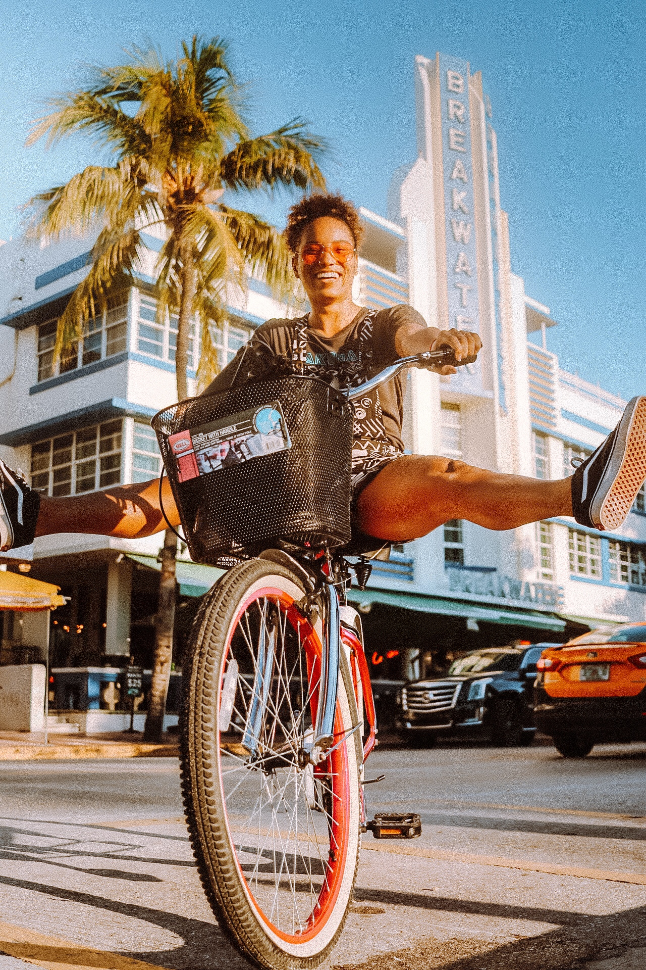 Illustrated by Sade - A woman riding a bike on Ocean Avenue Miami