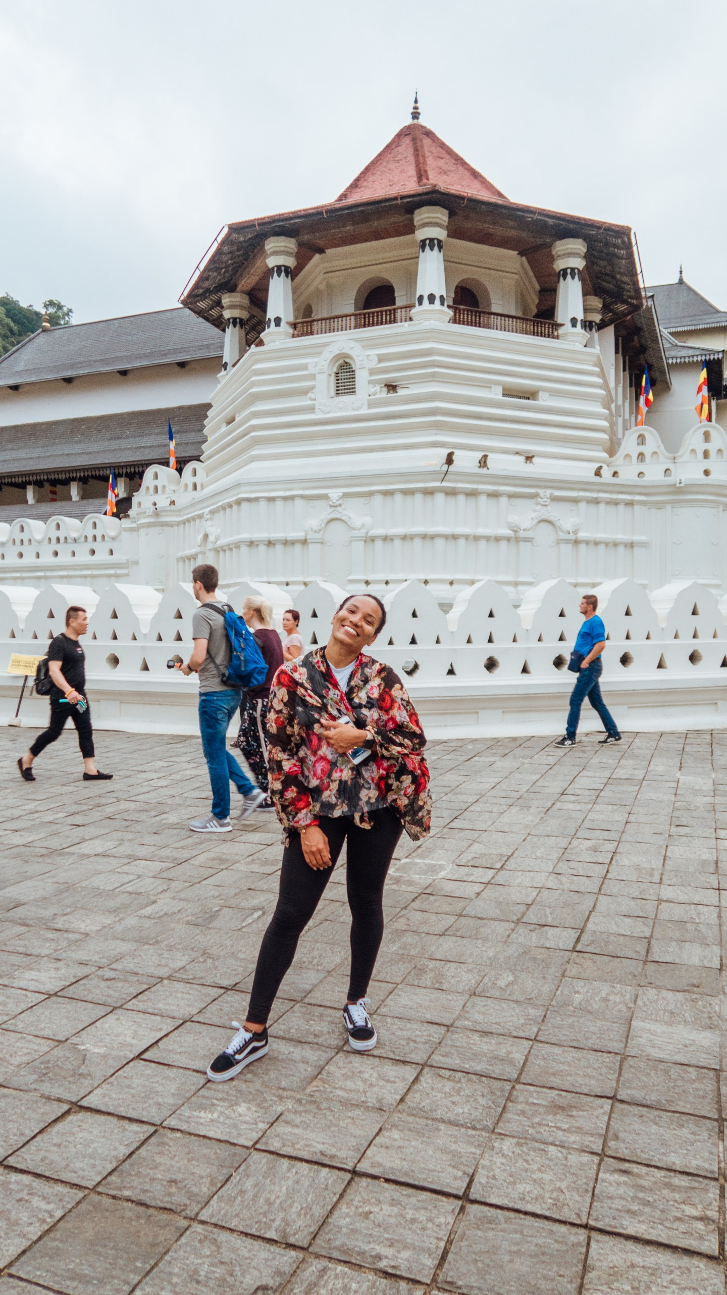 Illustrated by Sade - Woman taking photo in front of the Temple of Tooth Relic in Kandy, Sri Lanka