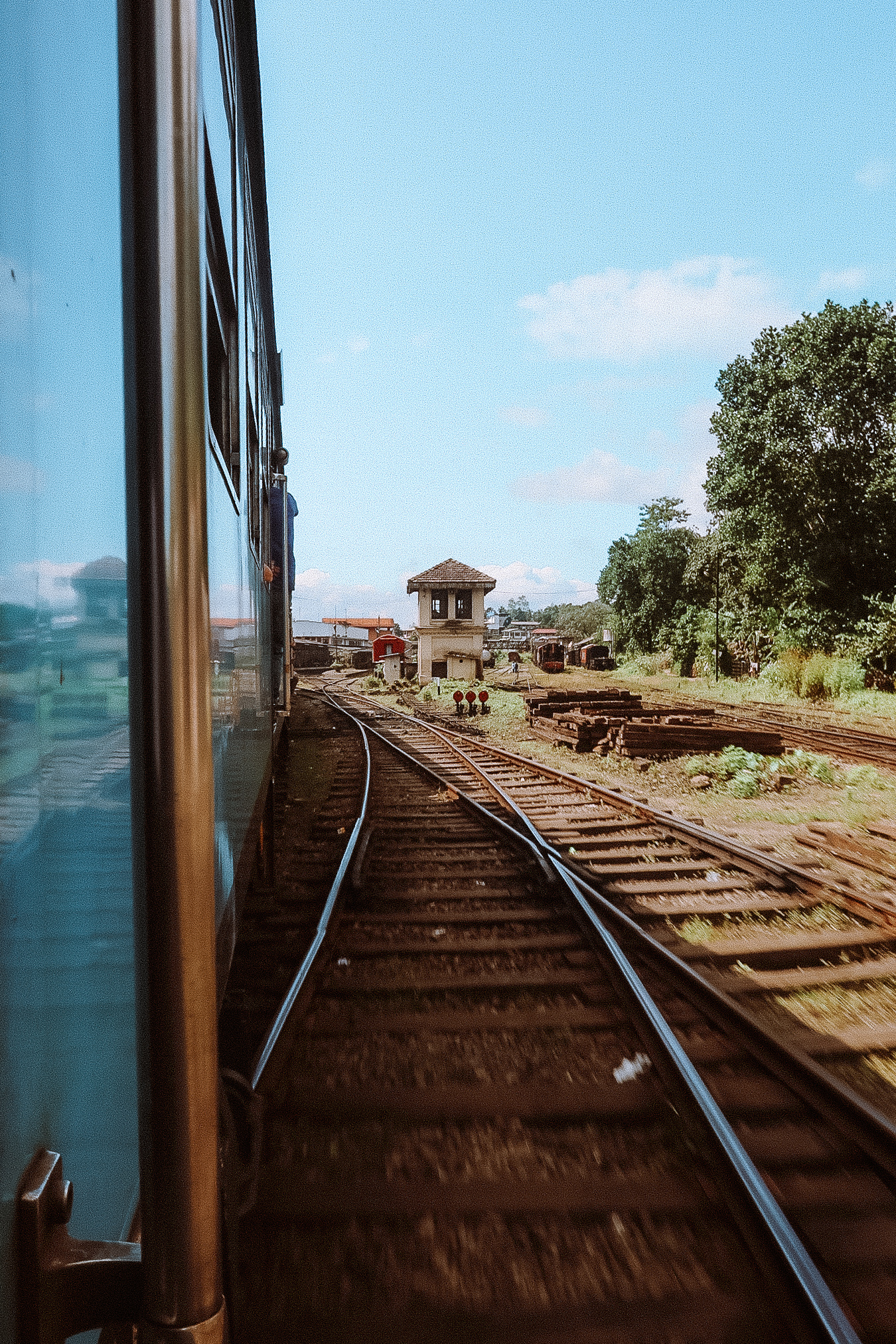 Illustrated by Sade - Moving train and tracks of the Kandy to Ella train.