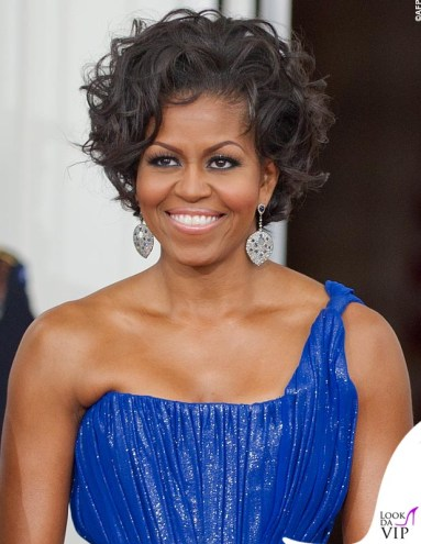 US First Lady Michelle Obama is seen during the arrival of the Mexican President and Mexican First Lady May 19, 2010 on the North Portico at the State Dinner for Mexico at the White House in Washington, DC. AFP Photo/Paul J. Richards / AFP PHOTO / PAUL J. RICHARDS