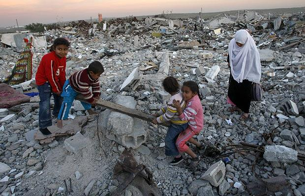 Palestinian children play in rubble