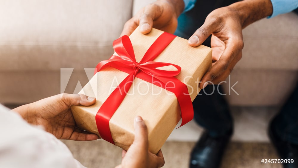 Birthday present. Father giving gift to daughter