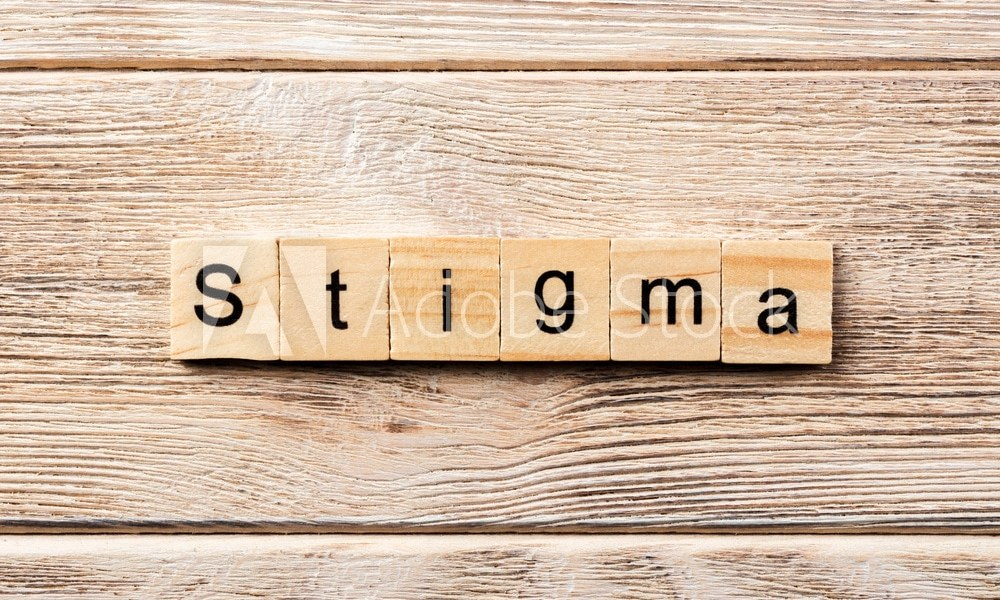 stigma word written on wood block. stigma text on table, concept