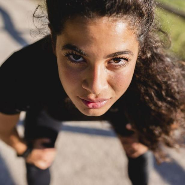 B_portrait-of-sportive-young-woman-having-a-break-royalty-free-image-1595860511