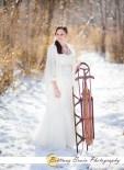 indianapolis-bride-antique-sled-ivory-wedding-gown-pearl-necklace-gold-bracelet-snow-winter-bridal-portrait-photographer