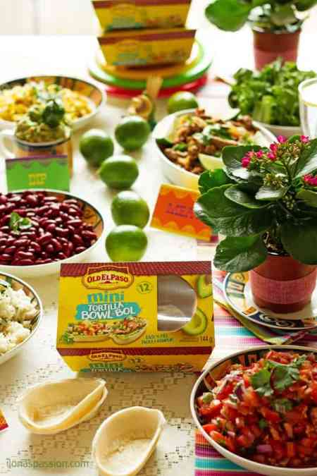 Mexican party with yummy recipes for barbacoa, lime cilantro rice, avocado dip, beans, tortilla bowls, corn and salsa. Get free printable Party Labels by ilonaspassion.com