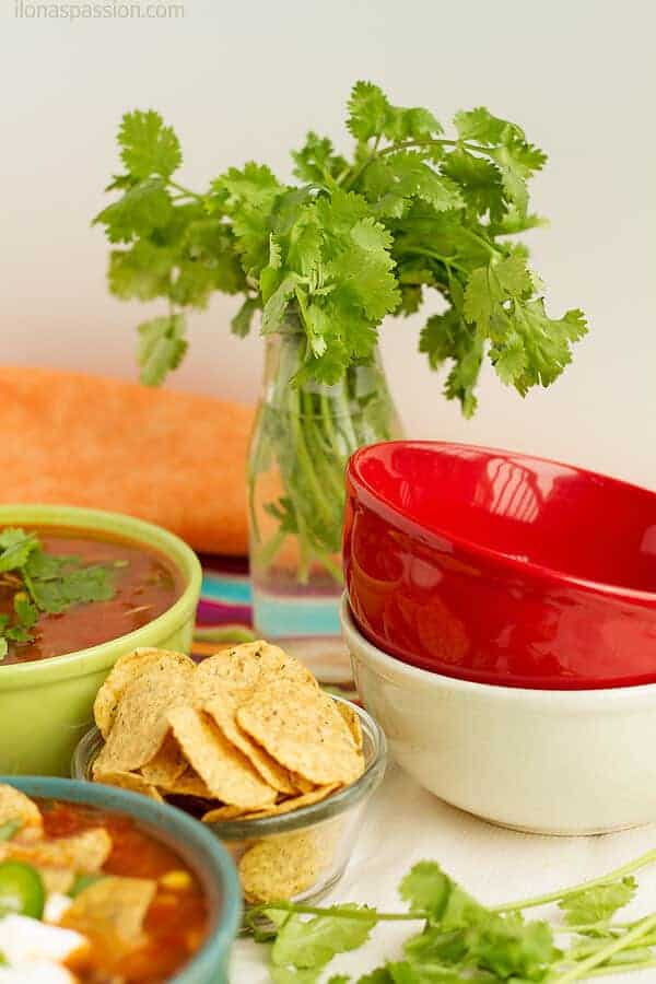Taco soup served with lots of cilantro and tortilla chips. The best party ever!
