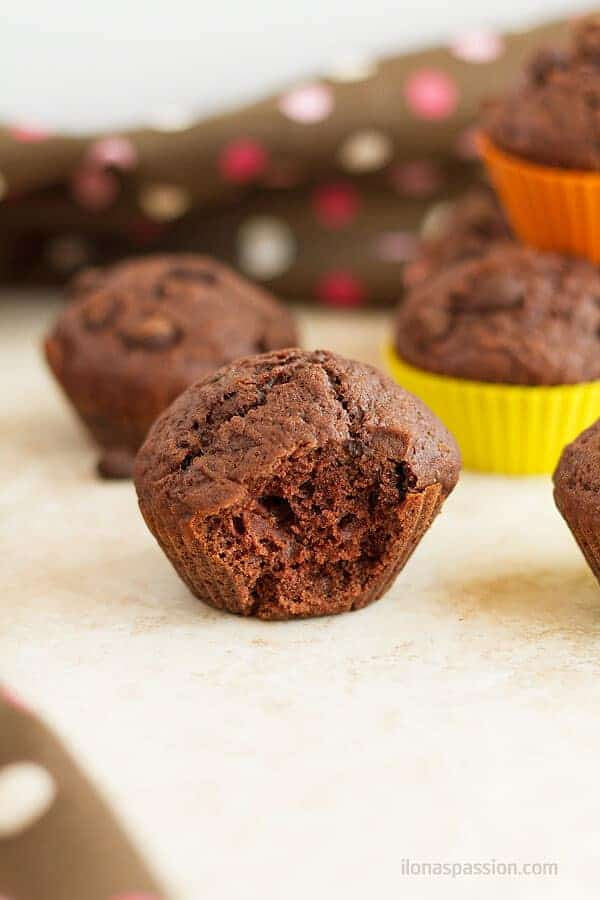 A bite of the double chocolate chip muffins made with simple ingredients that you already have at home!  by ilonaspassion.com I @ilonaspassion