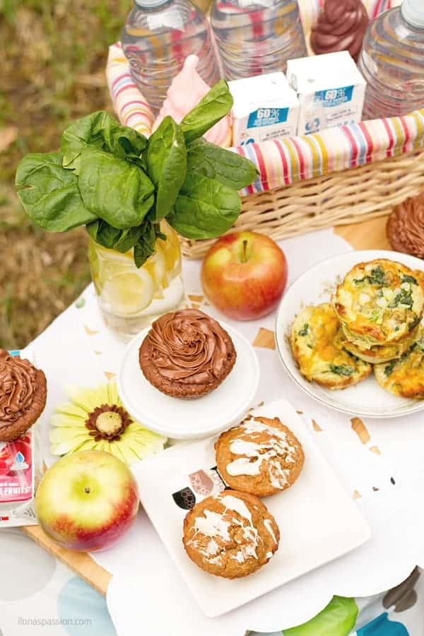 How to make picnic party in a park with muffins, chocolate and drinks.
