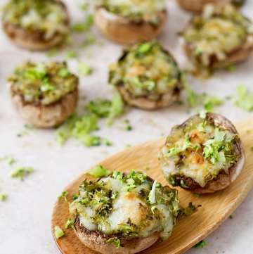 Baked mushrooms with broccoli and cheese.
