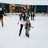 Family ice skating at SkyPark at Santa's Village