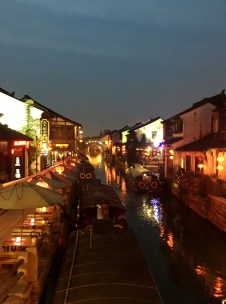 Shan Tang Street lined with shops and restaurants on both side of the canal.