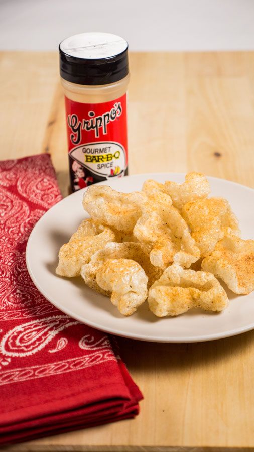Plate of pork rinds seasoned with Grippo's BBQ seasoning.