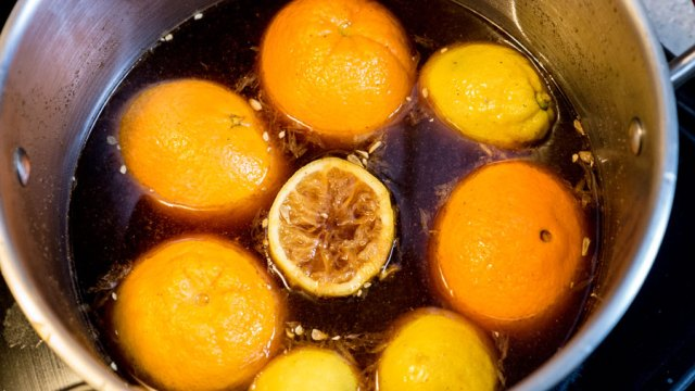Oranges floating in a pot of brine.
