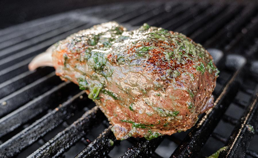 Double Cut lamb chop being grilled in a Big Green Egg.