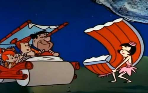 Fred Flintstone getting ready to eat ribs.