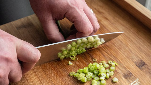 Dicing green onion with a chef knife