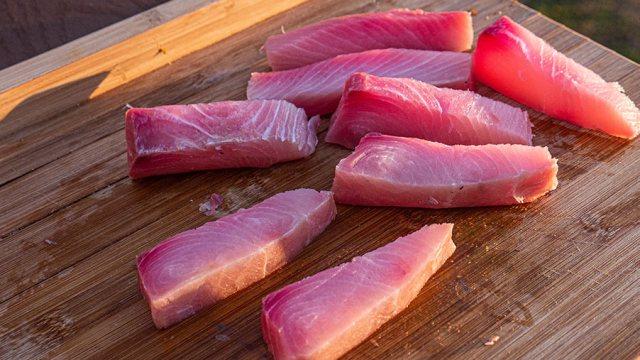 Freshly sliced Mahi filet on a cutting board.