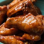 Sweet and sticky glazed wings in a turquoise bowl
