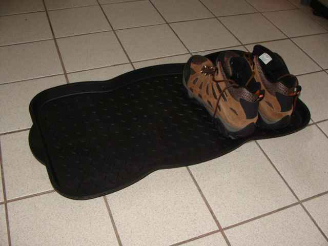 plastic tray meant for boots and shoes