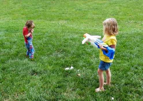 Kids playing with Super Soaker