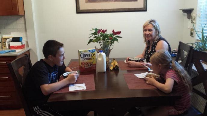 enjoying cheerios with my family