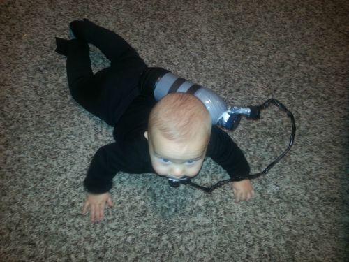baby swimming scuba diver
