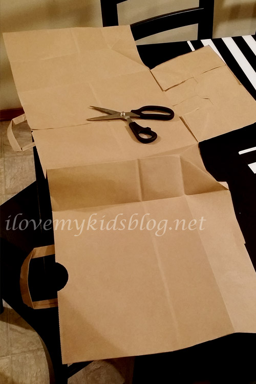 First step to the Upcycled Paper Banner is to cut the brown paper bag so it will lay flat