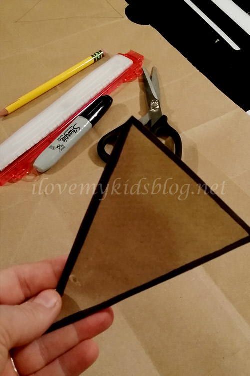 once cut out outline the shape to use as a stencil for your upcycled paper banner