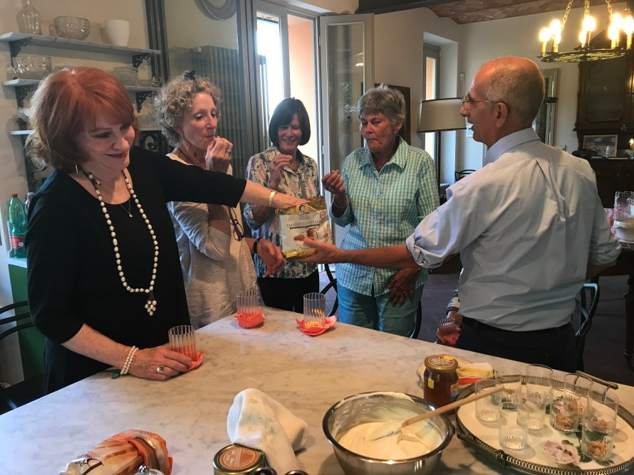 Sheryl and her friends tasting the amaretti cookies
