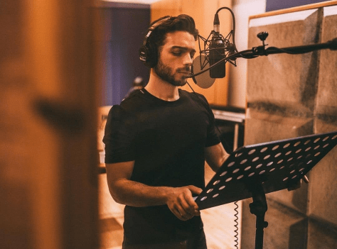 Gianluca in the studio singing at a microphone