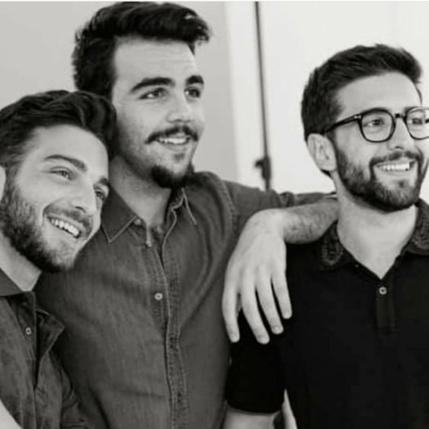 Left to right: Black and white photo of Gianluca, Ignazio and Piero all smiling