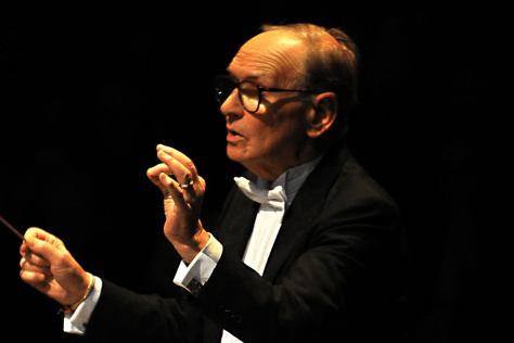 Close up of Ennio Moricone as he directs an orchestra