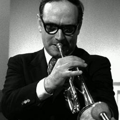 Black and white photo of Ennio Morricone playing the trumpet