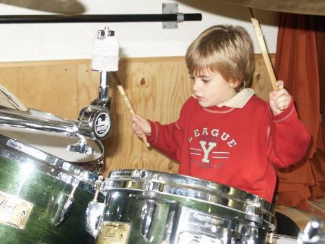 Young Nico playing the drums