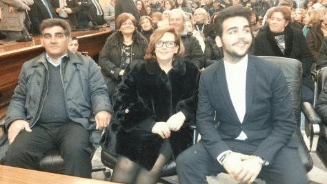 Left to right: Vito, wife Caterina sitting in an audience