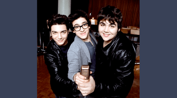 Left to right: A young Gianluca, Piero and Ignazio holding a microphone