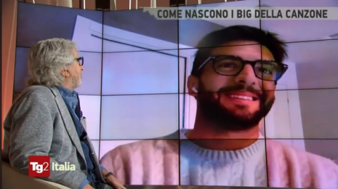 Michele looking at Piero smiling on screen