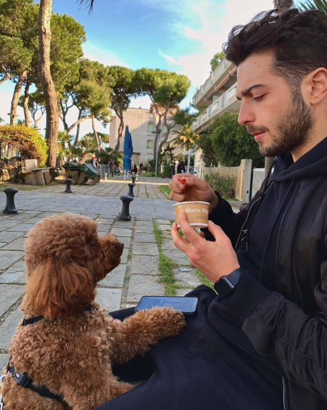 Gianluca and his dog Luna eating gelato