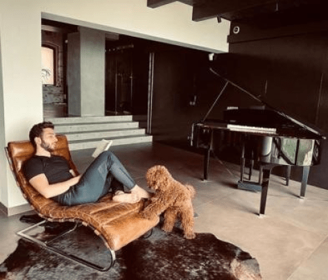 Gianluca at home with Luna the dog