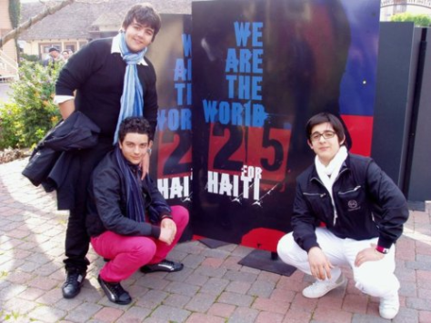 Left to right: Ignazio, Gianluca and Piero in front of a We Are The World sign