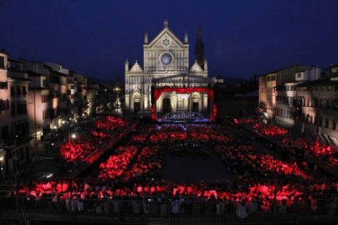 Beautiful night time picture of the PIazza Santa Croce with the stage and audience lit up in red