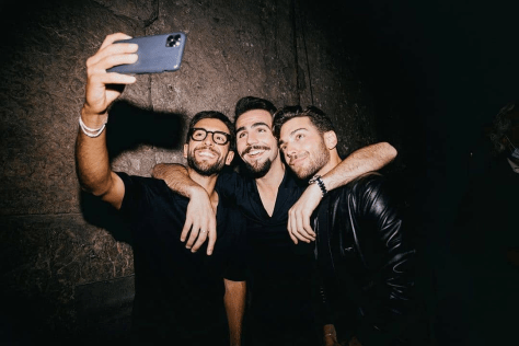 Piero taking a selfie of himself with Ignazio in the middle and Gianluca