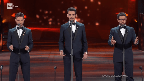 Left to right: Gianluca, Ignazio and Piero in tuxedos singing on stage