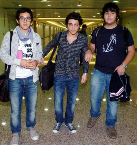 Left to right: A young Piero, Gianluca and Ignazio walking through an airport