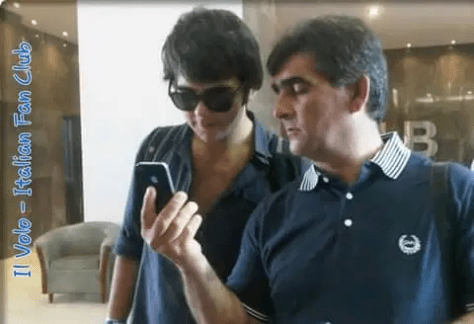 A teenage Ignazio and his Dad, Vito, looking at a cell phone