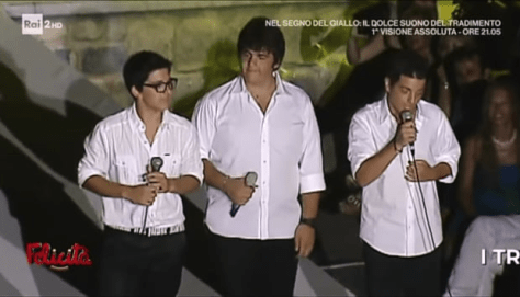 Left to right: A young PIero, Ignazio and Gianluca in white shirts singing