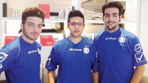 Left to right: Gianluca, PIero and Ignazio dressed in blue soccer uniforms