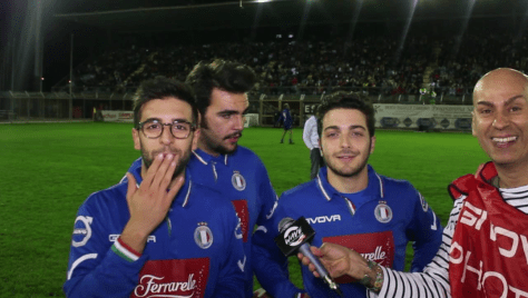 Piero, Ignazio and Gianluca on the soccer field being interviewed. Piero is blowing a kiss.
