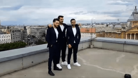 Left to right: Gianluca, Ignazio and PIero standing on a rooftop in Budapest